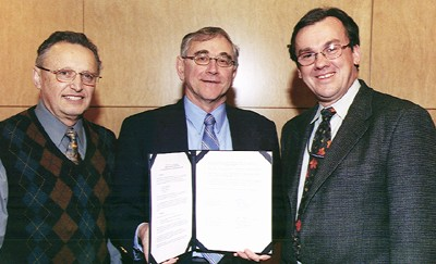 Left to right above: Efim Gluskin, Director of the Argonne Experimental Facilities Division; Bill Tomlinson, Executive Director of the CLSI and Murray Gibson, Associate Laboratory Director for the APS, with the signed Memorandum of Understanding.