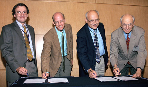 Pens at the ready, ANL Associate Laboratory Director and APS Director Murray Gibson (left); John Hill (BNL), Executive Director of IXS-CDT; ANL Deputy Laboratory Director Donald Joyce; and Miles Klein (U. of Illinois at Urbana-Champaign), IXS-CDT Executiv