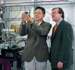David H. Mao (left) showing a panoramic high-pressure diamond-anvil cell to Murray Gibson, inside the beamline 16-ID-D research station. The integrated high-pressure facility at HP-CAT is opening myriad new research frontiers in multidisciplinary physical