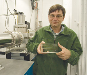 Keith Brister (Northwestern University), manager of LS-CAT, displays the acrylic block that was used to record first light into the 21-ID-D enclosure (see photo below for a close-up).