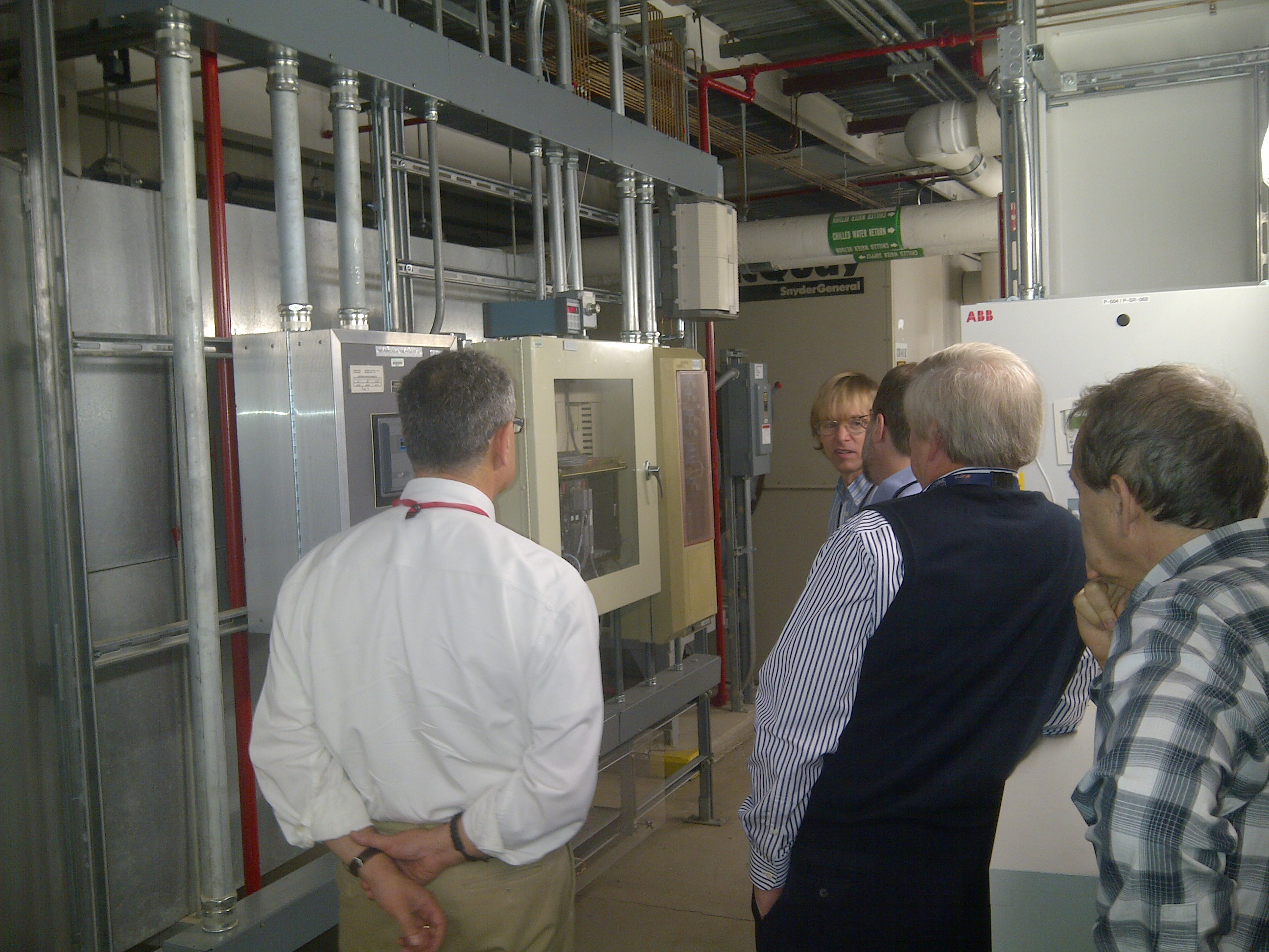 October 3 2014 Lester Erwin ASD-Dia discussing  air temperature monitoring and measurements  in the storage ring tunnel at APS with members of the ALD office.