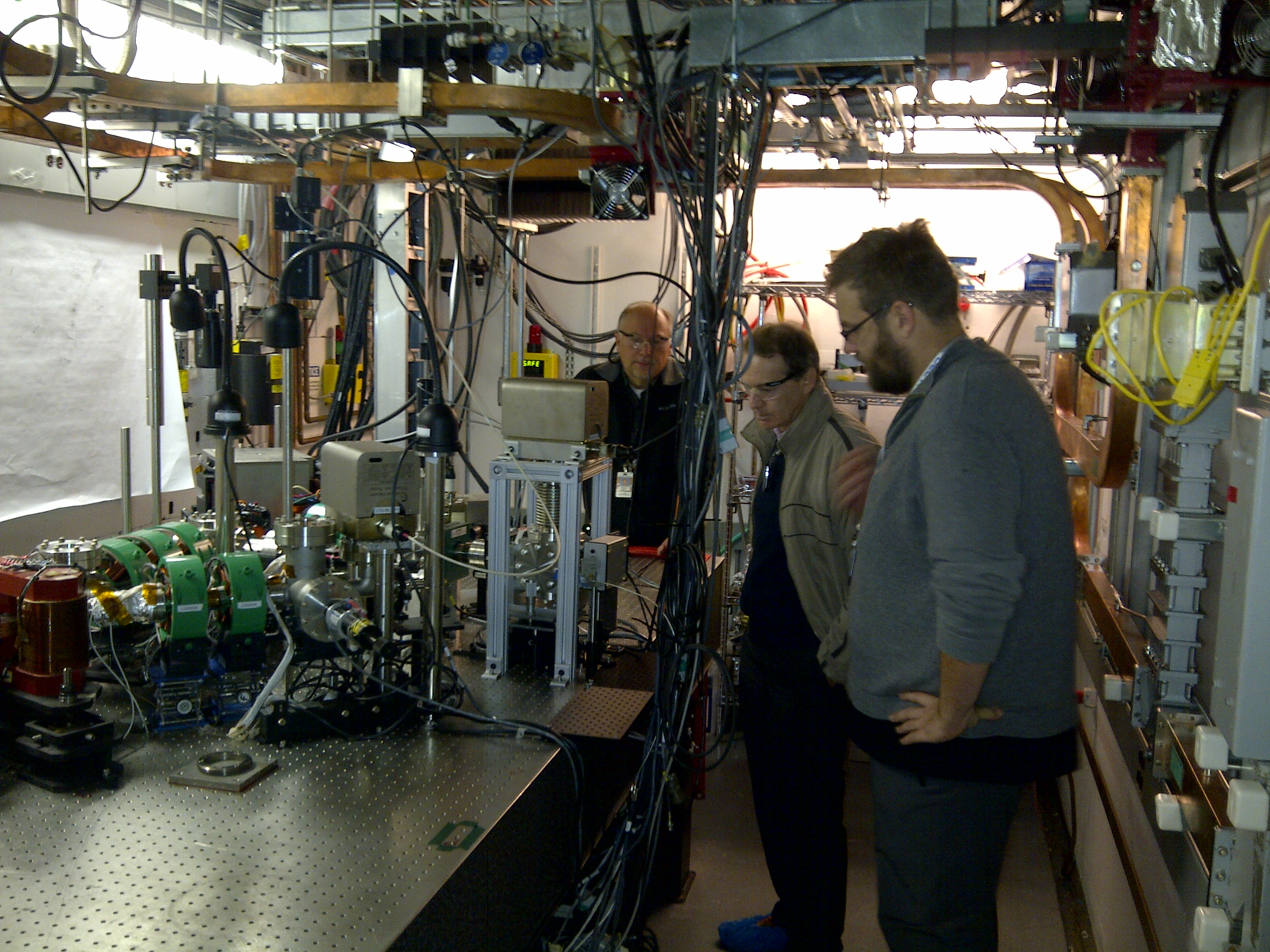 Sasha, Stan and Joshah Hartzell from Radia Beam discuss the   the generation of Tera-Hertz (THz) radiation using a rf thermionic gun with an alpha magnet to provide bunch compression inthe Injector Test Stand