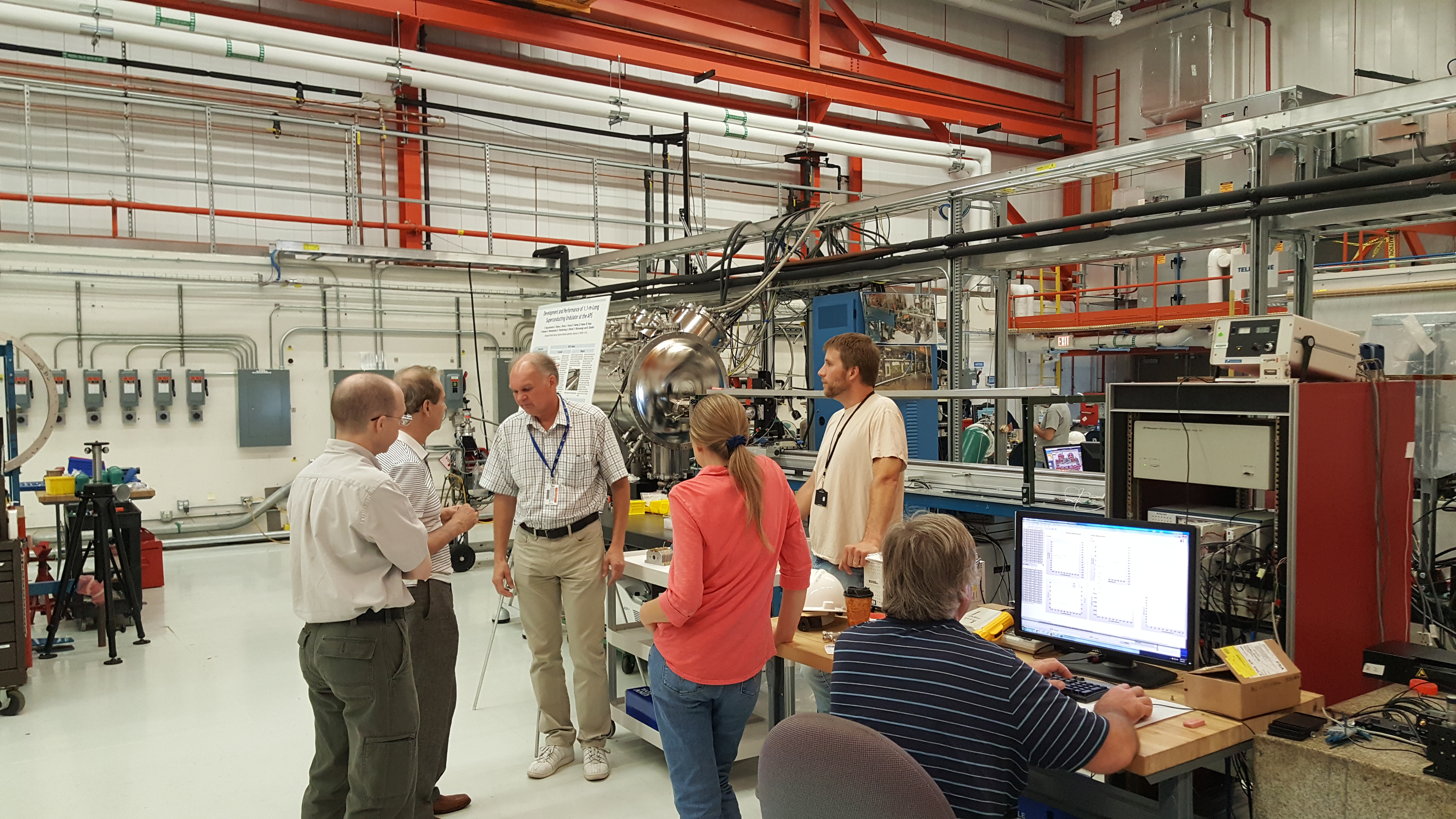 MD Group discussing magnet measurement