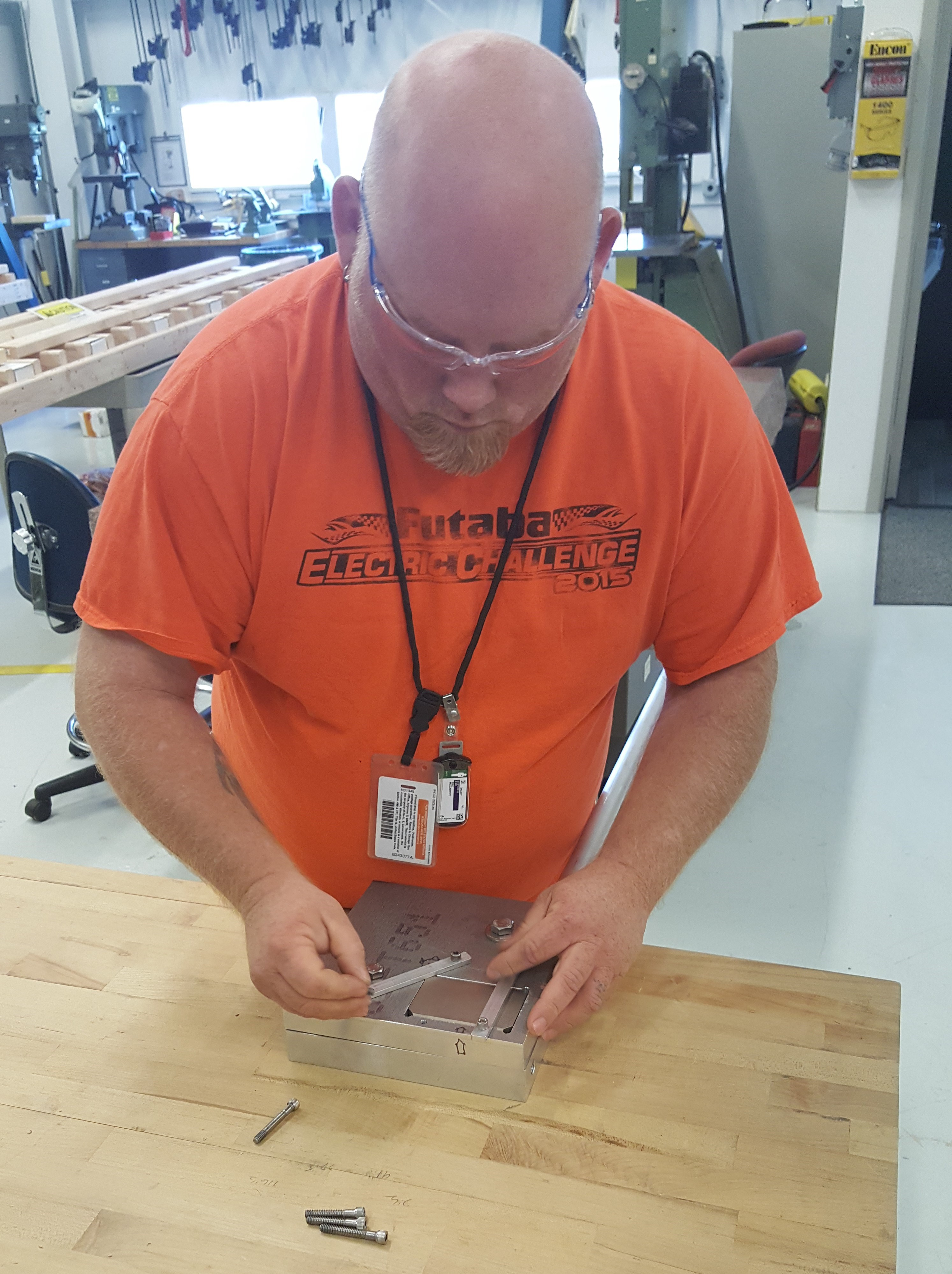 MD Group demonstrating in house designed tool for installing XLEAP magnet assemblies