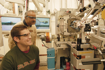 Zachary A. Bornholdt (foreground) and B. V. Venkataram Prasad (both Baylor Medical School) in the SBC-CAT 19-ID research station.