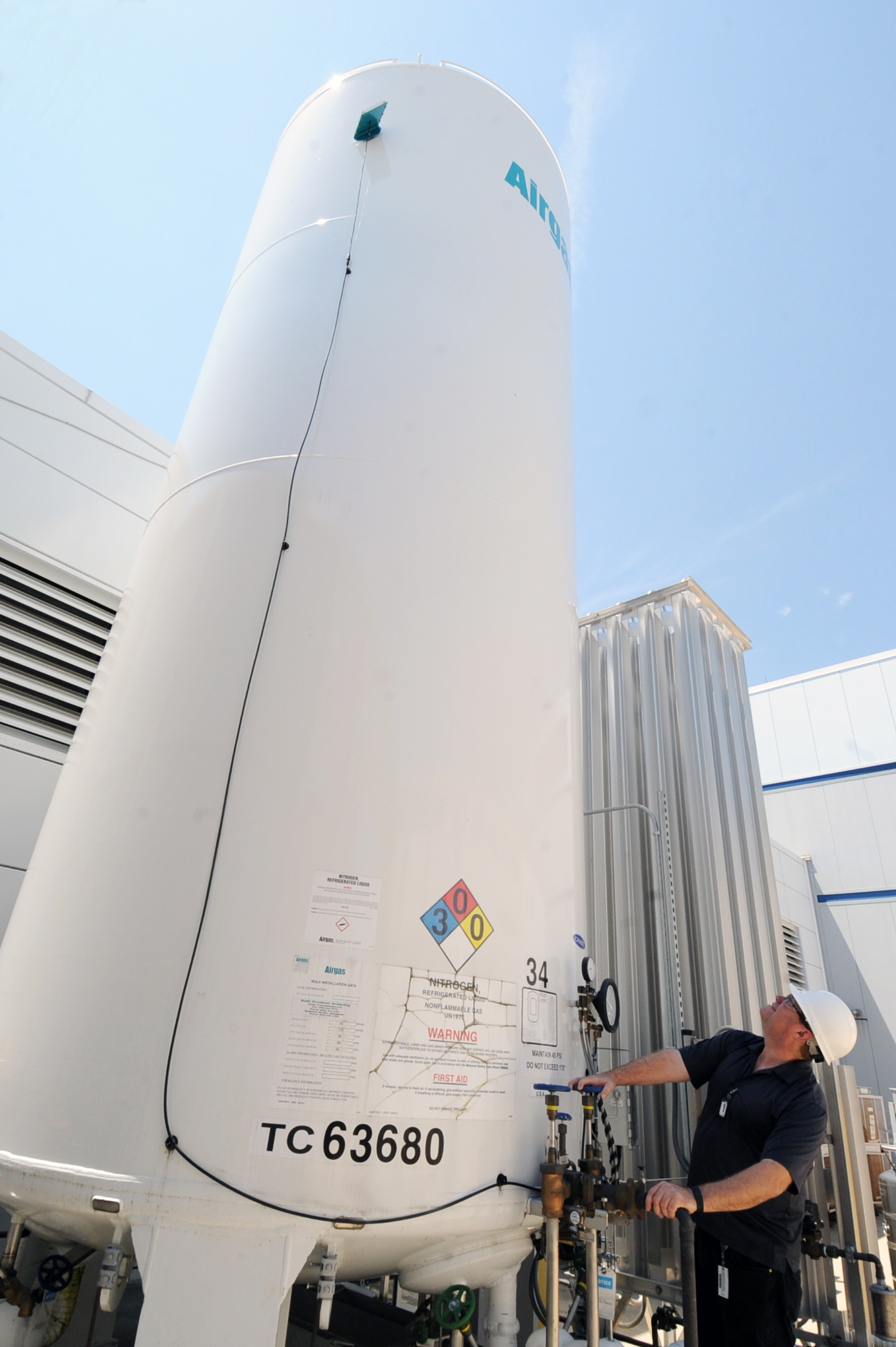 Andy Stevens (FMS) and one of the new 9,000-gallon LN2 tanks. Click image to enlarge.