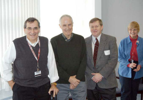 Jim Viccaro (left; Executive Director, Center for Advanced Radiation Sources [CARS]), Philip Coppens (SUNY Buffalo), Denny Mills (Deputy ALD, APS), and Joy Talsma (Executive Administrator, CARS) at the reception for Dr. Coppens held on February 11, 2005,
